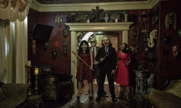 Masked Group in Room - The Mortuary Haunted House - New Orleans Haunted House